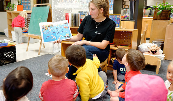 teacher reading to students in the preschool program at the asi children's center