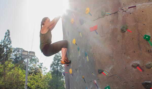 student climbing at the asi recreation center climbing park
