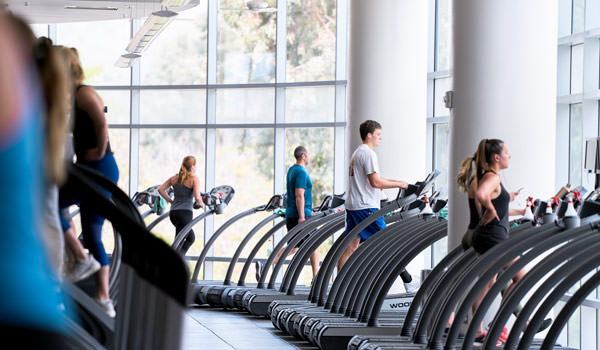 students running on treadmills at the cal poly recreation center