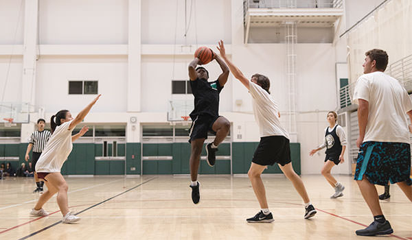 students playing pickup basketball at the cal poly recreation center
