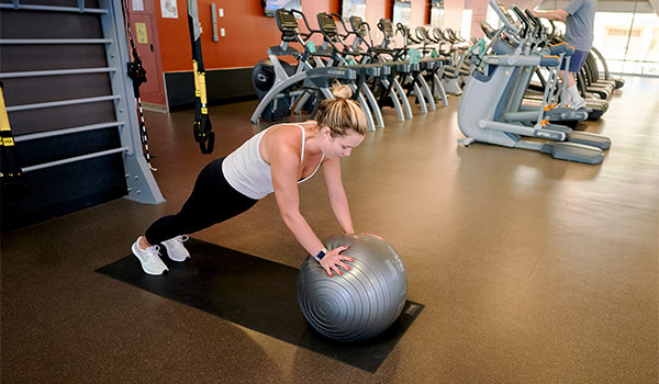 student exercising with a yoga ball at the cal poly recreation center