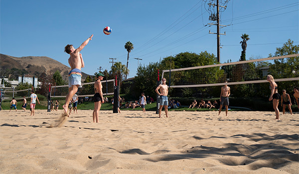 students playing sand volleyball at the cal poly recreation center