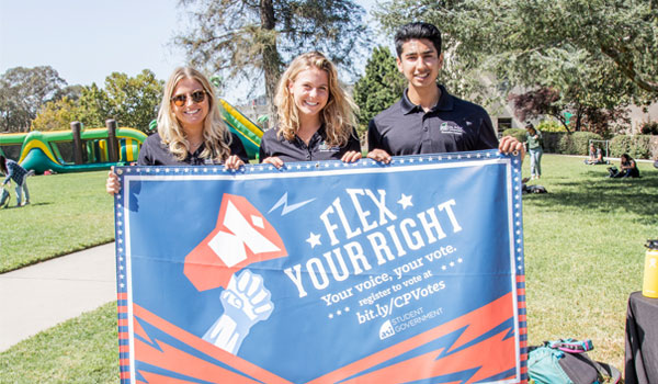 Students holding up a banner that says Flex Your Right to vote