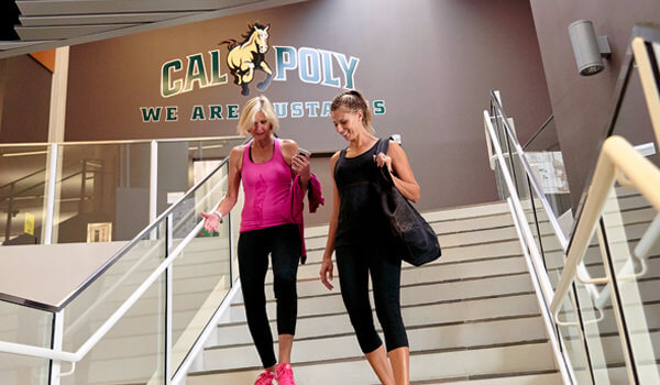 Two Cal Poly ASI Recreation Center members walking down the stairs